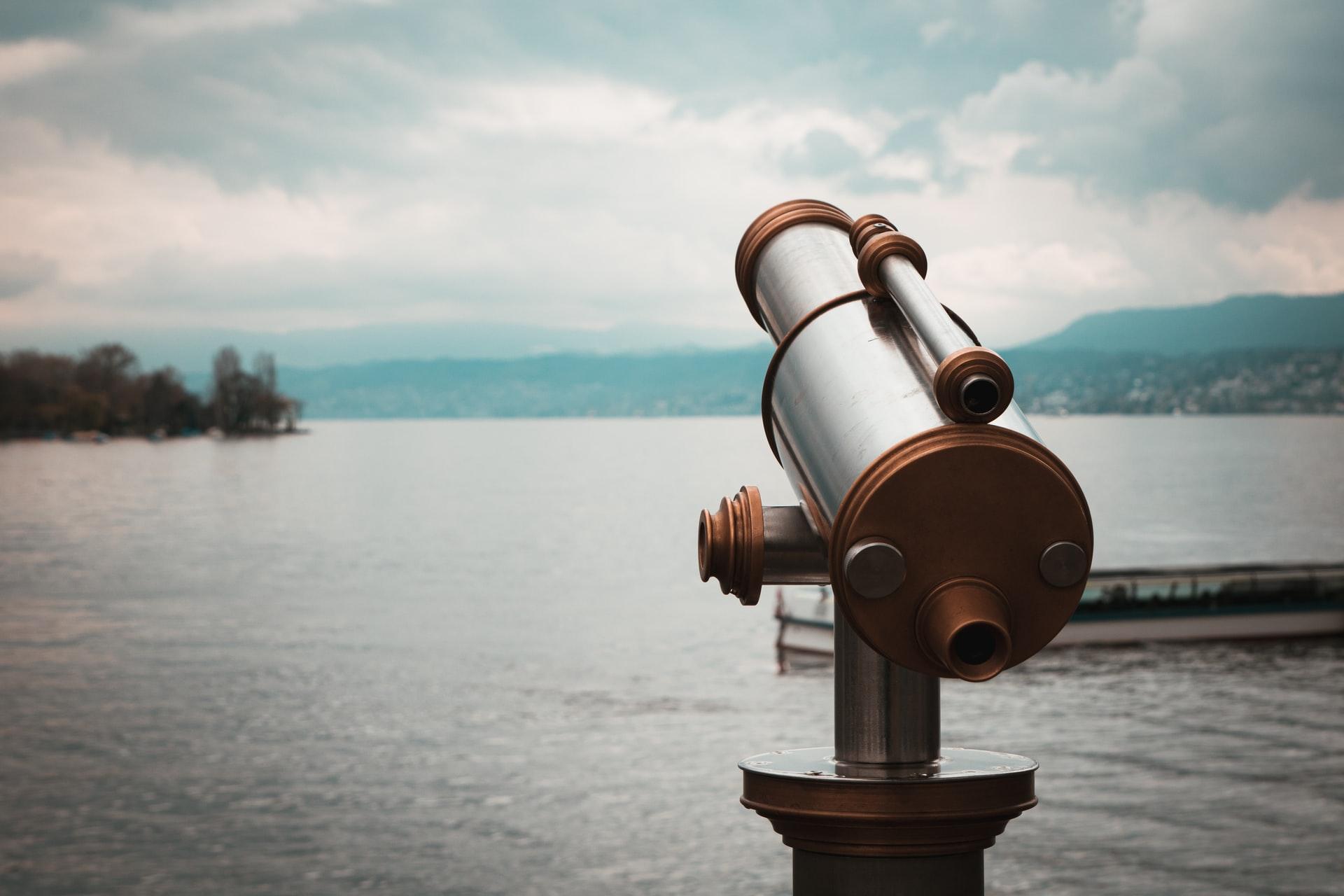A telescope by a lake.